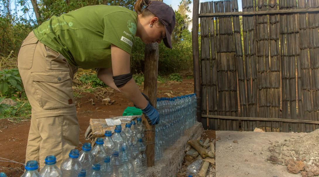 Conservation volunteers build a wall out of plastic materials to raise awareness on recycling in Ecuador